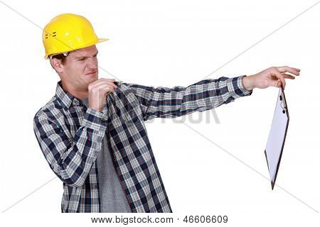 Construction worker holding a distasteful clipboard