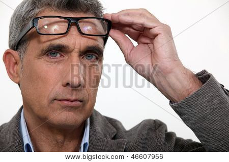 Man raising his glasses
