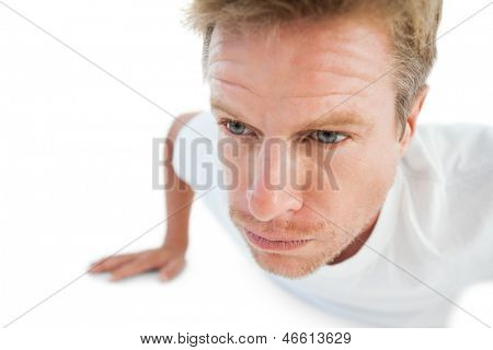 Man doing pressups on white background