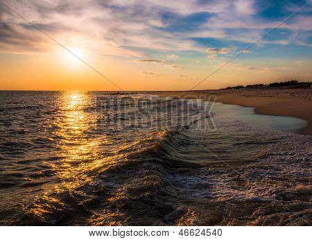 The Sun Setting Over The Atlantic Ocean, Cape May, New Jersey.
