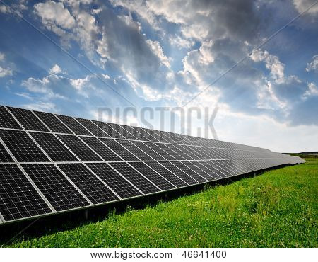 Solar energy panels in the setting sun poster