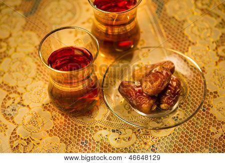 Dates and black tea