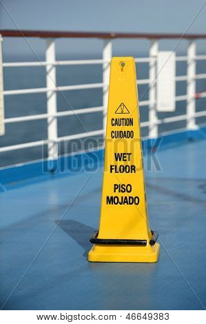 Caution Wet Floor sing on deck of cruise ship