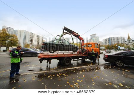 MOSCOW - OCT 13: Evacuation vehicle for traffic violations at the entrance to the park Sokolniki on October 13, 2012 in Moscow, Russia.