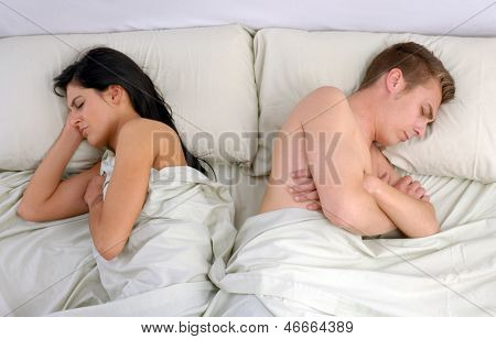 annoying couple sleeping on bed.