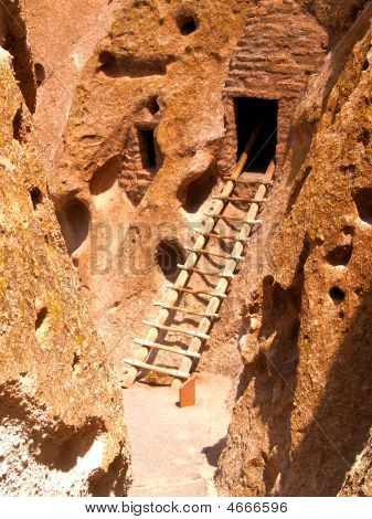 A ladder leads up to an ancient cliff dwelling at Bandalier National Monument in New Mexico USA poster