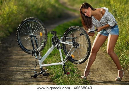 Bicycle has flat tyre and woman pump it up