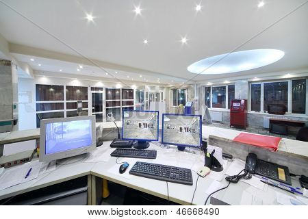 Computers of security guards in reception area in office building.