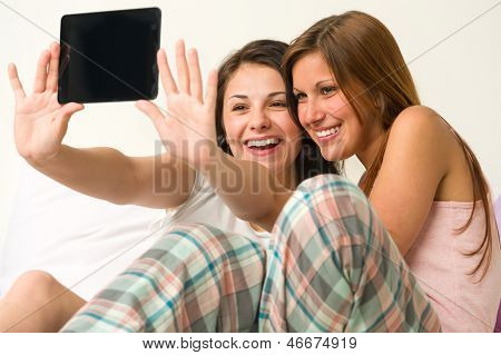Pretty young girls taking pictures of themselves smiling poster