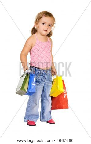 Little Girl With Colorful Shopping Bags