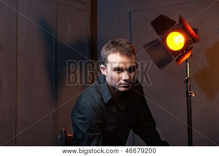Closeup portrait of man in studio with flashes