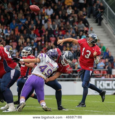 VADUZ, LIECHTENSTEIN - JULY 21 QB Marko Glavic (#13 Broncos) passes the ball on July 21, 2012 in Vaduz, Liechtenstein.