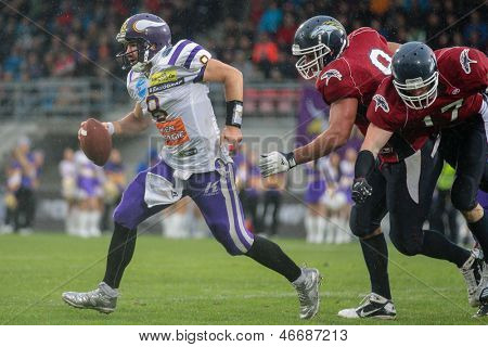 VADUZ, LIECHTENSTEIN - JULY 21 QB Christoph Gross (#8 Vikings) runs with the ball on July 21, 2012 in Vaduz, Liechtenstein.