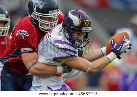 VADUZ, LIECHTENSTEIN - JULY 21 WR Kyle Kaiser (#3 Vikings) is tackled on July 21, 2012 in Vaduz, Liechtenstein.
