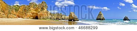 Panorama from rocks and ocean at Praia Tres Irmaos in Alvor Portugal
