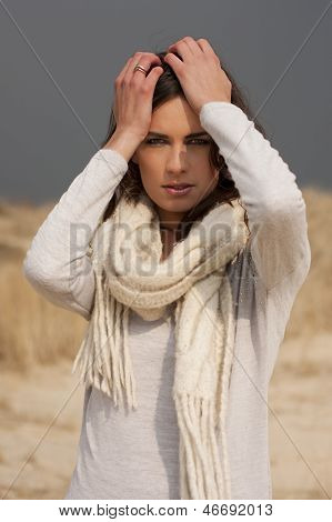 Beautiful Woman Wearing Grey Shirt And White Scarf In The Dunes