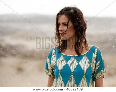 Beautiful Woman Wearing Blue And Gold Shirt In The Snow