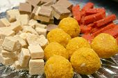 assortment of indian candies for auspicious occasions poster