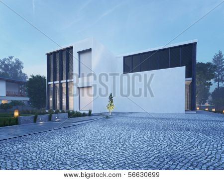 Modern house exterior with outdoor lighting at twilight