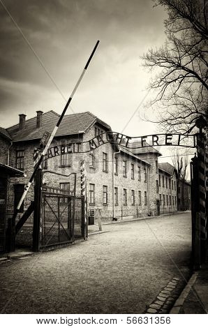 Arbeit macht frei sign (Work liberates) in concentration camp Auschwitz, Poland poster