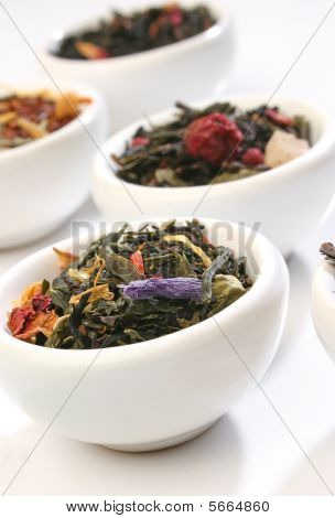 Various bowls of premiun tea leaves