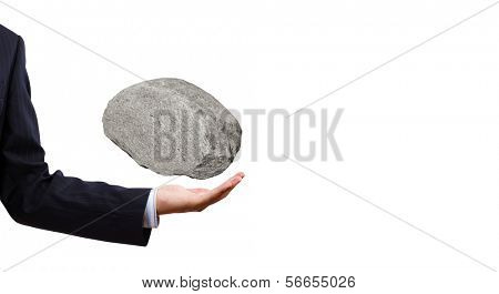 Businessman in suit huge holding stone in palm