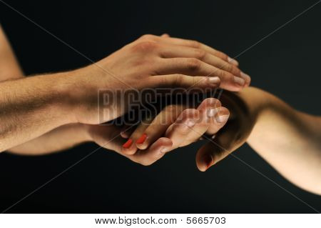 Hands caring and supporting each other