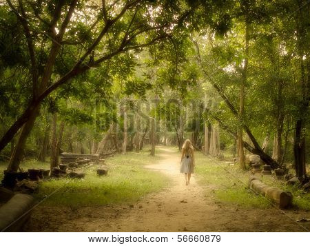 Young Woman Walking on Path into Enchanted Forest