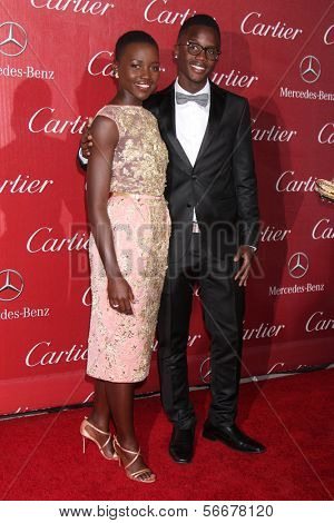 PALM SPRINGS - JAN 4:  Peter Nyong'o (brother), Lupita Nyong'o at the Palm Springs Film Festival Gala at Palm Springs Convention Center on January 4, 2014 in Palm Springs, CA