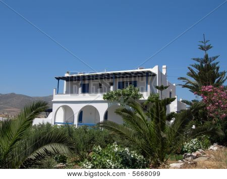 typical cyclades greek island guest house motel architecture with whitewashed building with arches and blue doors on paros island greece poster