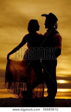 Silhouette Cowboy Couple Hold Dress Facing