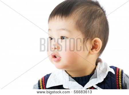 Little boy looking at a side