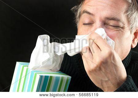 Man Blows Nose
