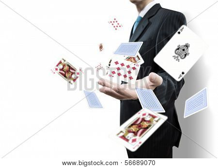 Close up of businessman throwing cards. Gambling concept