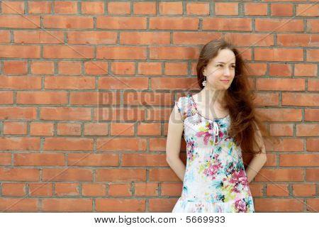 Girl Near The Brick Wall