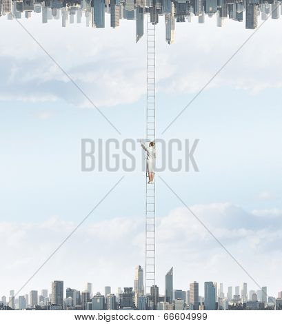 Businesswoman standing on ladder between two realities