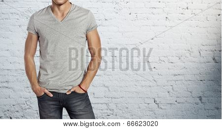 Young handsome man wearing blank grey t-shirt