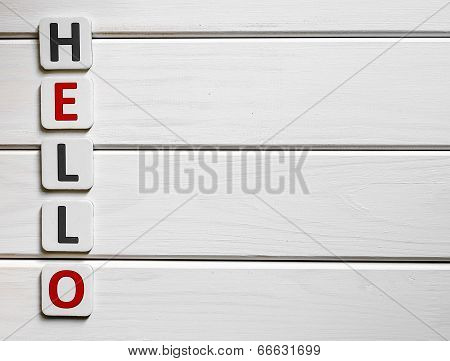 Hello word composed of letters on a background of wood poster