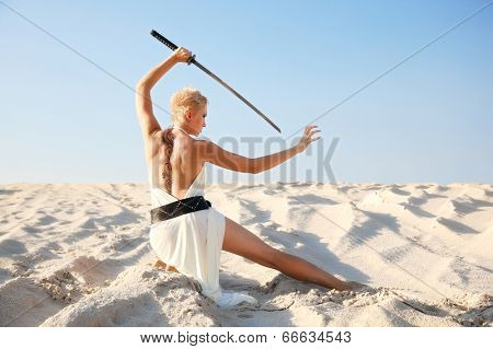 militant girl with sword in morning light