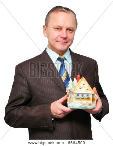 The businessman is dreaming of a new house isolated on white