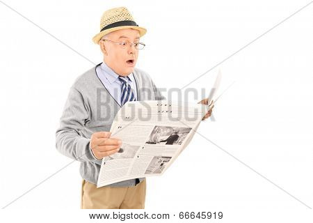Surprised senior gentleman reading the news isolated on white background