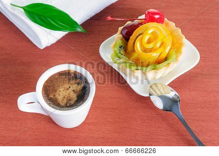 Cupcake With Jelly And Fruits And A Cup Of Coffee