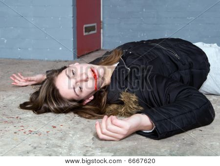 Murdered woman on a concrete basement floor with blood splatter and blood in a fresh crime scene poster