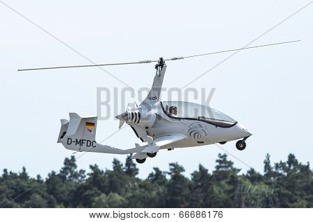 BERLIN, GERMANY - MAY 20, 2014: The Arrowcopter FD-Composites AC-10 (D-MFDC) helicopter, demonstration during the International Aerospace Exhibition ILA Berlin Air Show.