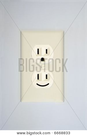 "A duplex receptacle shows a standard ""surprised face"" and an additional ""smiling face"". poster"