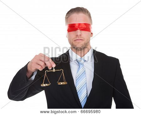 Lawyer With Scales Of Justice Wearing A Blindfold