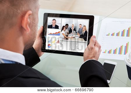 Businessman On A Video Or Conference Call On His Tablet