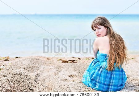 Woman Sitting Alone At The Beach