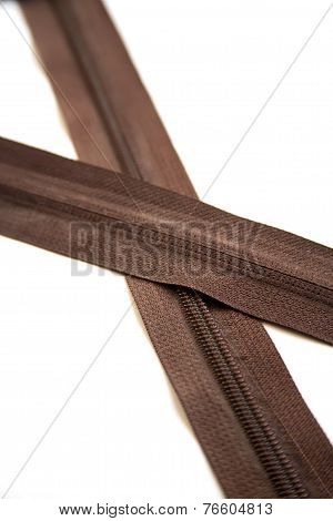 Brown zipper isolated on white background