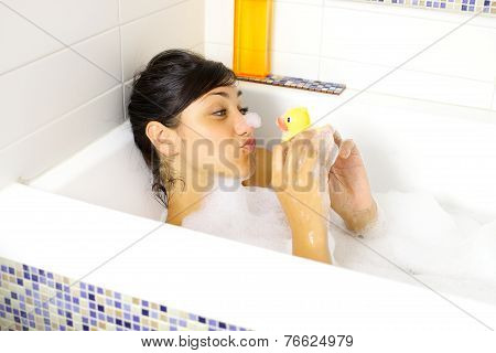 Happy Woman Enjoying And Relaxing Bath Tub With Yellow Duck